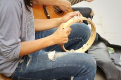 A man is playing tambourine at the park Stock Photo