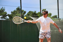 Man playing tennis Stock Images