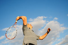 Man playing tennis. Action shot of man playing tennis royalty free stock photos