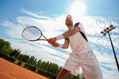 Man playing tennis. In court in nature stock images