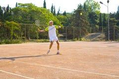 Man playing tennis Stock Photo