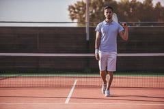 Man playing tennis Stock Photos