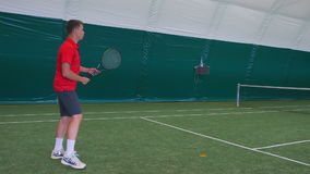 Man playing tennis with young guy on grass court stock footage