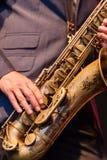 Man playing a tenor saxophone stock image