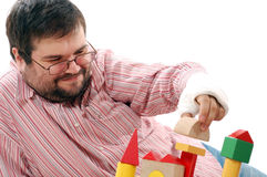 Man playing with toy bricks Stock Image