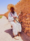 Man playing traditional moroccan instrument. Royalty Free Stock Photo