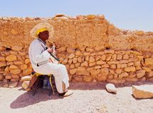 Man playing traditional moroccan instrument. Stock Image