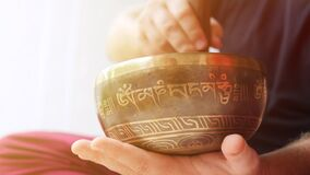 Man Playing on Traditional Tibetan Bronze Singing Bowl. Yoga Meditation Zen Practice with Calm Sounds for Good Energy. And Health. 4K, Slowmotion stock video