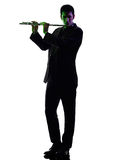 Man playing  transverse flute player  silhouette Stock Image