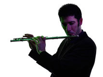 Man playing  transverse flute player  silhouette Stock Photo