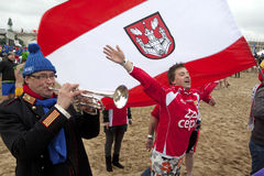 Man playing trumpet on the beach Royalty Free Stock Photos