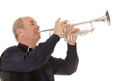 Man playing trumpet on a white Royalty Free Stock Photos