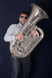 Man playing a tuba. Portrait of the man playing a tuba Stock Photo