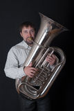 Man playing a tuba. Portrait of the man playing a tuba Royalty Free Stock Photo