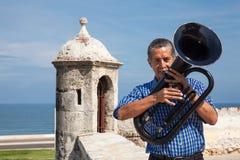 Man playing tuba at Cartagena de Indias. CARTAGENA, COLOMBIA - OCTOBER 2009. Man playing tuba at Cartagena de Indias wall Royalty Free Stock Images