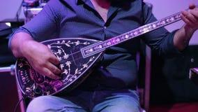 Man playing on turkish saz guitar. Turkish wedding stock footage