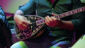Man playing on turkish saz guitar. Turkish wedding stock video