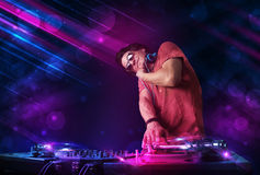 Man playing on turntables with color light effects Royalty Free Stock Photos