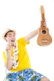 Man playing ukulele and singing Stock Images