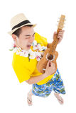 Man playing ukulele and singing Stock Image