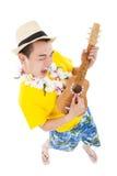 Man playing ukulele and singing Stock Image