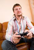 Man playing a video game Royalty Free Stock Photography