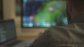Man playing in video game on computer stock video footage