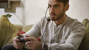 Man playing video game and talking with online players Stock Photography