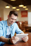 Man Playing Video Game Using  Tablet Stock Photo