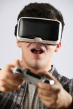 Man Playing Video Game Wearing Virtual Reality Headset Royalty Free Stock Photos