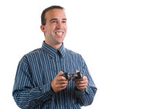 Man Playing Video Games. A young man using a remote control to play video games, isolated against a white background Royalty Free Stock Image