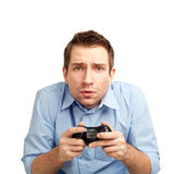 Man playing video games. Curious student playing video games. Isolated on white background Royalty Free Stock Images