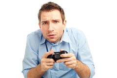 Man playing video games. Curious student playing video games. Isolated on white background Royalty Free Stock Photo