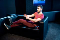 Man playing video games with gaming console in the club stock photo
