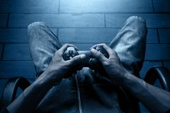 Playing video games at night. Man playing video games at night Royalty Free Stock Image