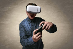 Man playing video games wearing vr. Headset Stock Images