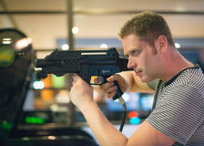 Man playing video shooting game. Royalty Free Stock Photo