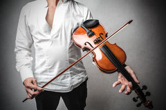 Man playing the violin Stock Images