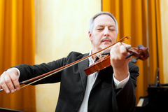 Man playing violin Stock Images
