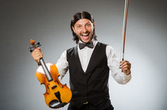 Man playing violin in musical concept Stock Photography