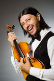 Man playing violin in musical concept Stock Photo