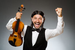 Man playing violin in musical concept Royalty Free Stock Images