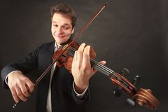 Man playing violin showing emotions and expressions royalty free stock images