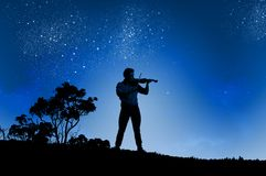 Man playing violin Stock Photos