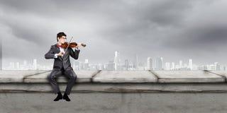 Man playing violin Stock Photography