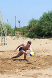 Man playing volleyball on the beach Royalty Free Stock Image