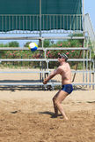 Man playing volleyball on the beach Stock Photo
