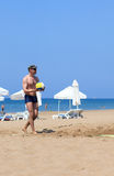 Man playing volleyball on the beach Royalty Free Stock Photo