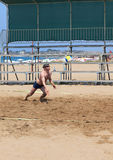Man playing volleyball on the beach Stock Image