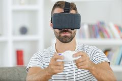 Man playing with vr oculus googles royalty free stock images